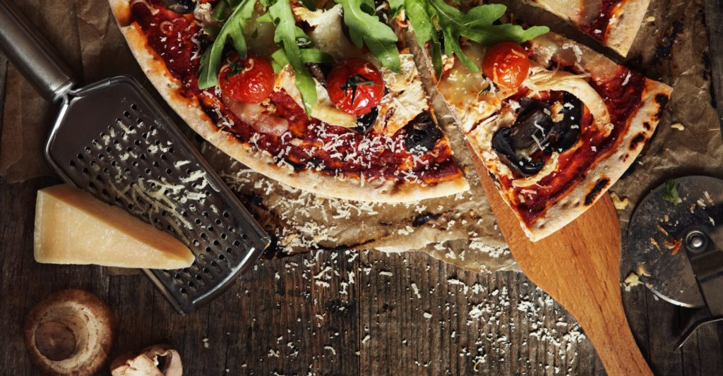 Col Cacchio pizza with grated parmesan cheese
