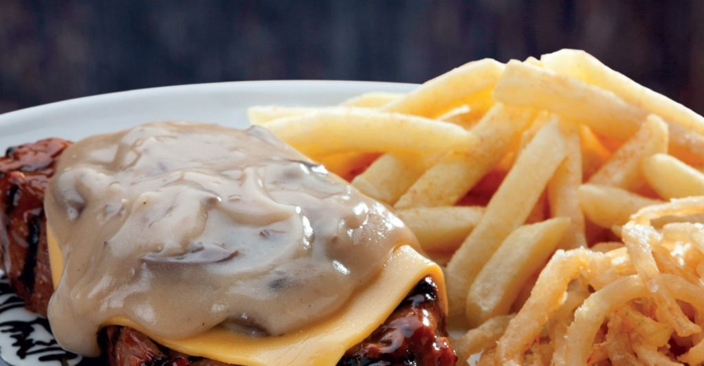 Spur Rump or Sirloin topped with a slice of melted cheese and creamy mushroom sauce.