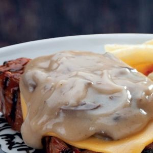 Spur Rump or Sirloin topped with a slice of melted cheese and creamy mushroom sauce. Chips and onion rings side