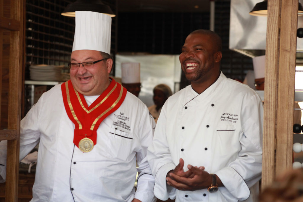 Chef Benny laughing alongside another chef