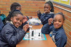 Grade 3 learners playing chess at Hartzstraat Primary