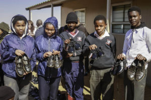 Learners holding donated School Shoes