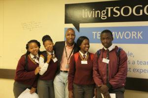 Patrick Mungani, Financial Accountant at Silverstar Casino, with students from Mosupatsela Secondary School in Kagiso.