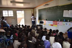Tshepo Mokoena, Silverstar CSI Administrator, reading to a Gr1 class