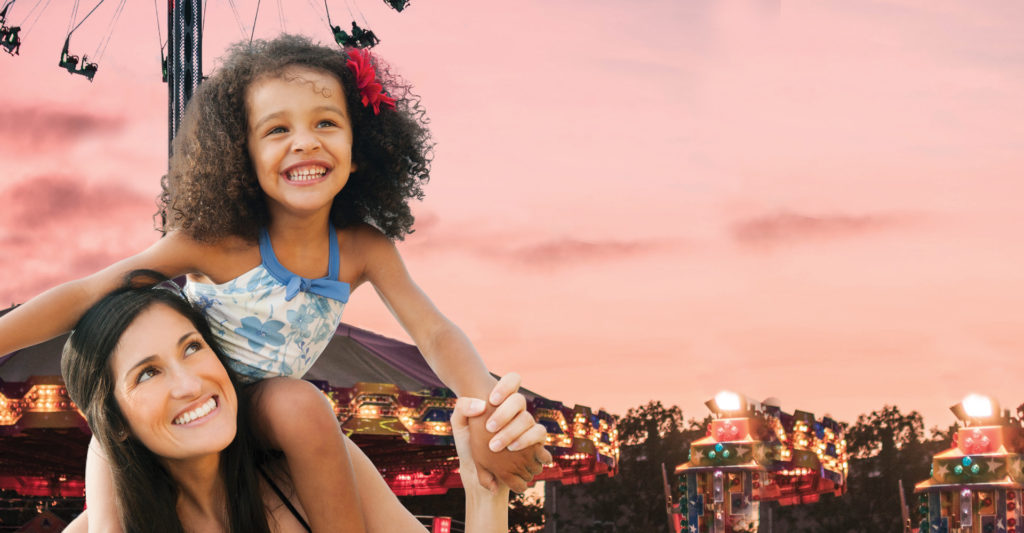 Silverstar Family Fun header image with mother and daughter in the forefront and rides in the background